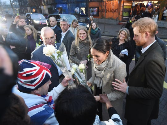 Prince Harry and Meghan Markle greet people in Brixton,
