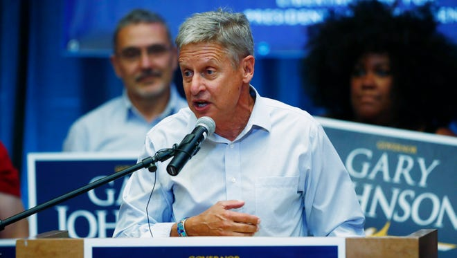 In this Oct. 3, 2016, photo, Libertarian presidential candidate Gary Johnson speaks during a rally in Parker, Colo.