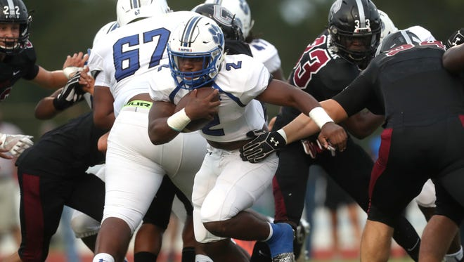 Godby's Tony Street runs the ball against Chiles at Chiles High School on Friday, Aug. 25, 2017.