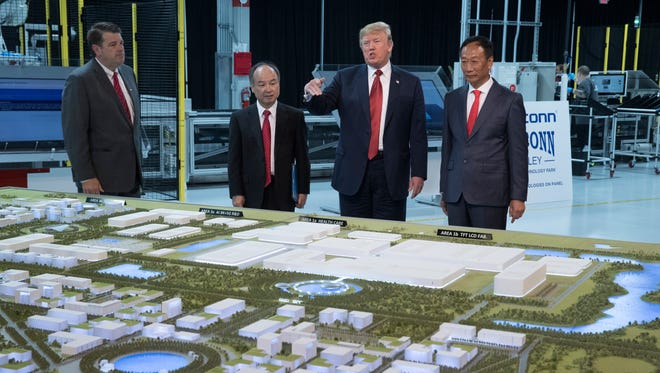 President Donald Trump with a model of the Foxconn facility that is being built in Racine County.