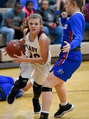 Henderson's Kaytlan Kemp (20) drives around Apollo's Lexi Shadowen (3) as Henderson County plays Apollo High at Henderson's Colonel Gym Monday, November 27, 2017.