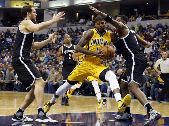 Pacers forward Paul George drives to the basket against