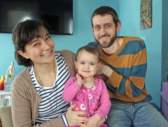 Alexsis Moore was diagnosed with hyperemesis gravidarum, an extreme morning sickness in the early stage of her pregnancy with daughter Margot. Alexis is photographed with her husband, Todd and daughter Margot, 16 months at their home in Ossining on Feb. 25, 2014.
