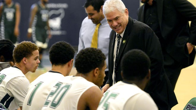 Pensacola State College men's basketball coach Pete Pena talks to his team during a game last season. The Pirates will host No. 1 Northwest Florida State on Saturday night.