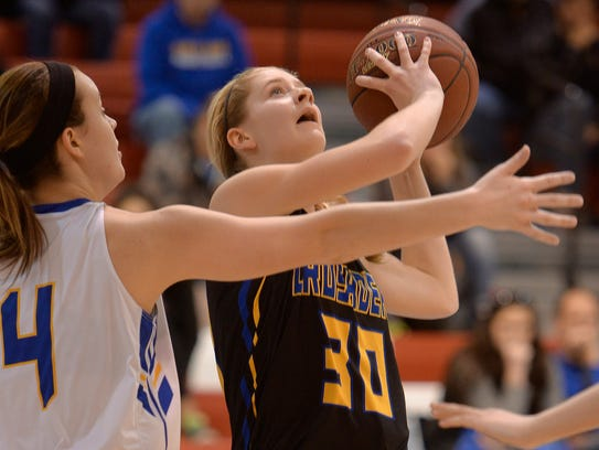 St. Cloud Cathedral's Meg Januschka (30) goes up for