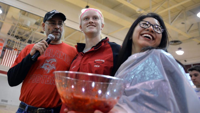 Vineland High School National Honor Society Jello eating contest girls winner Ibette Cruz-Lopez (right) smiles as her victory is announced by School Board president Scott English (left), and NHS president Emma King (center), Tuesday, Mar. 15, 2016.