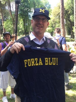 "Jim Harbaugh shows off his ""Forza Blu!"" T-shirt on Sunday at the Borghese Gardens."