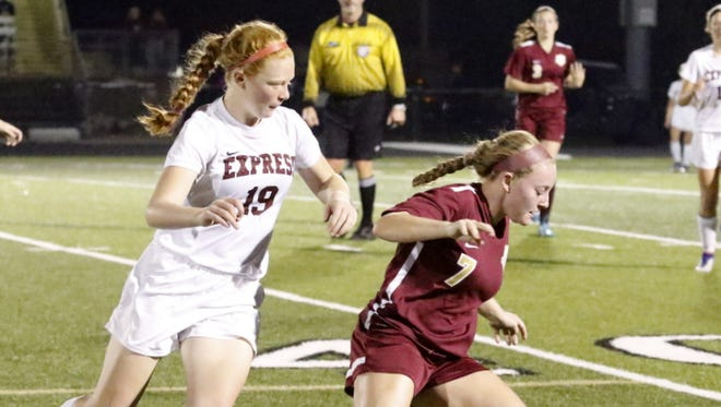 Arlington's Allie Coon controls the ball as Elmira's Caylee Boorse chases from behind Wednesday night during a Class AA girls soccer regional semifinal at Corning Memorial Stadium.