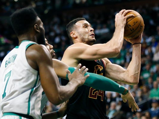 """FILE - In this Feb. 11, 2018, file photo, Cleveland Cavaliers' Larry Nance Jr. (24) drives for the basket against Boston Celtics' Greg Monroe, behind left, and Jaylen Brown (7) during the fourth quarter of an NBA basketball game in Boston. Nance has run into an unexpected snag since joining the Cavaliers. """"Trying to convince my mom that I'm not living at home,"""" he said, smiling. """"We're out looking for rental properties and stuff like that and she's like, 'Oh, our basement is pretty nice.' That's probably been the toughest thing."""" (AP Photo/Michael Dwyer, File)"""