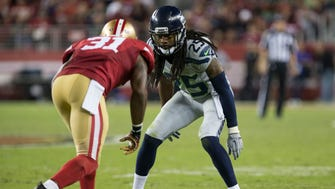 Seattle Seahawks cornerback Richard Sherman (25) defends San Francisco 49ers defensive back L.J. McCray (31) on a punt during the fourth quarter at Levi's Stadium.