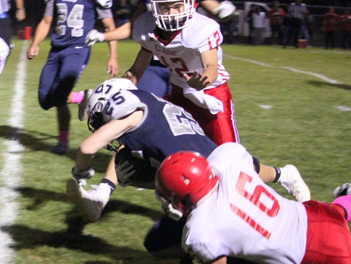 Silver's Trey Jameson dives across the endzone during