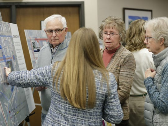 Rick Detienne, left, Sue Detienne and Vicky Rotzel, right, speak with library director Colleen Rortvedt during an open house information session on the new Appleton Public Library proposal and mixed-use development Thursday at the Appleton Public Library.