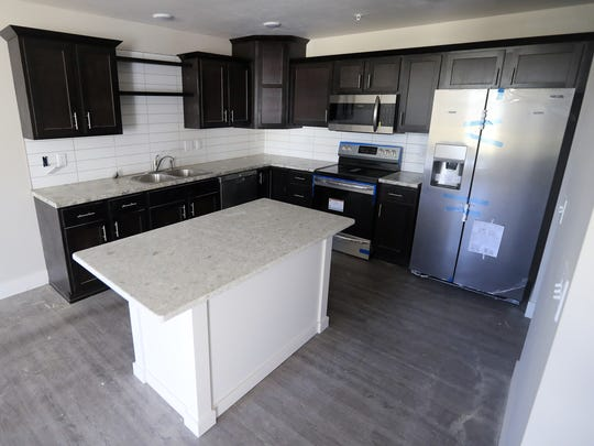 The kitchen inside one of the five townhouses under construction at Stuart and Jackson Streets in downtown Green Bay.