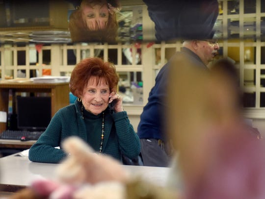 Joan Schmitt, 90, talks to a customer on the phone