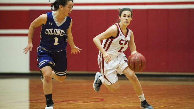 CVU's Nicole Eaton (2) dribbles the ball down the court past Brattleboro's Kai Boyd (1) during the girls basketball game between the Brattleboro Colonels and Champlain Valley Union Redhawks at CVU high school on Thursday night December 22, 2016 in Hinesburg.