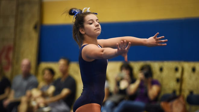 Melissa Ricciardi of Pascack Regional performs in the floor exercises during the gymnastics meet against Ramapo at Indian Hills High School in Oakland on 9/25/17.