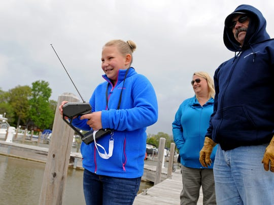 Reese Kulman, 10, of St. Clair, tries her hand at operating an RC boat Sunday, May 15, at the St. Clair Boat Harbor.