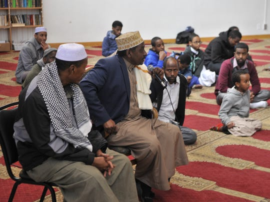 Members of the Central Minnesota Islamic Center gather