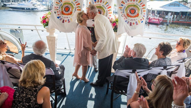 Lacey King and Alan Goodridge kiss at the end of their surprise wedding ceremony held on the Naples Princess on Saturday, April 21, 2018.