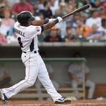 Tennessee Smokies shortstop Addison Russell bats during a baseball game against the Jacksonville Suns at Smokies Park in Kodak on Thursday, July 10, 2014.