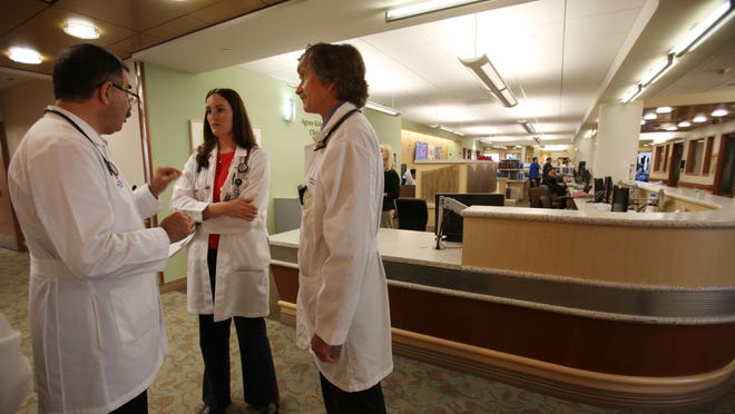 (From left) Samih Jarjour, MD, attending physician, Anna Nabet, MD, first year Family Medicine resident, and Mark Minot, MD, second year Family Medicine resident talk after making their rounds to patients at Eisenhower Medical Center on Thursday, January 29, 2015 in Rancho Mirage, Calif.