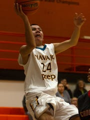 Navajo Prep's Thomas Montanez attempts a layup against Crownpoint on Friday at Lillywhite Gym in Aztec.