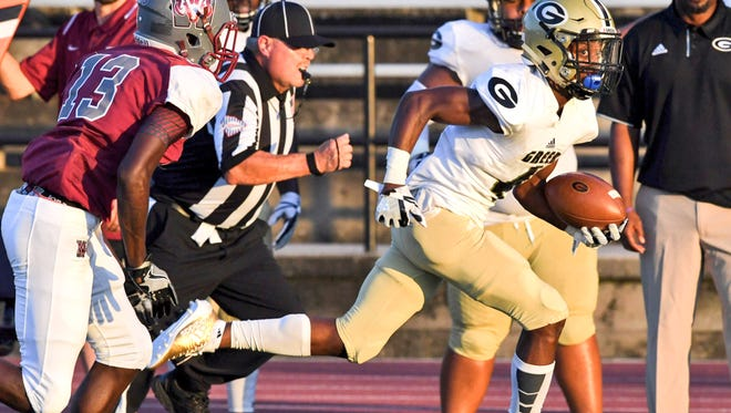 Greer sophomore Cameron Martin runs by Westside senior safety Octavious Tate on a fourth-and-three situation during the first quarter at Westside High School in Anderson on Friday. Martin scored on the play.