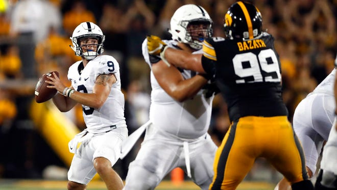 Penn State quarterback Trace McSorley (9) throws during the first half of an NCAA college football game against Iowa, Saturday, Sept. 23, 2017, in Iowa City, Iowa. (AP Photo/Jeff Roberson)