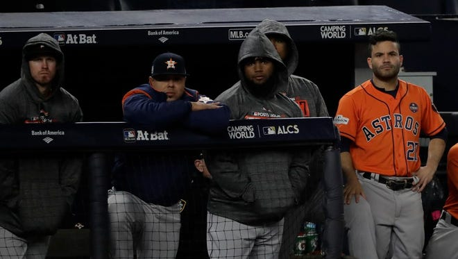 The Astros watch from their dugout at Yankee Stadium Tuesday night during the ninth inning as the Yankees close out a shocking 6-4 win in Game 4 of the ALCS. Houston blew a four-run lead.