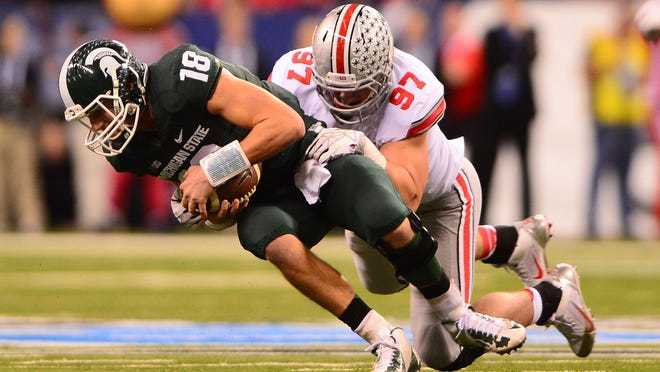 Ohio State defensive lineman Joey Bosa (97) sacks Michigan State's Connor Cook (18) during the first quarter of last December's Big Ten Championship game. Bosa has 10 sacks and 14 1/2  tackles for loss so far this season.
