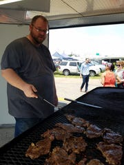 Dan Todd of Up in Smoke grills up a big mess of ribeye steaks waiting to be made into sandwiches. He also offers burgers, hotdogs, chicken and barbecue from his Niagara General Store restaurant.