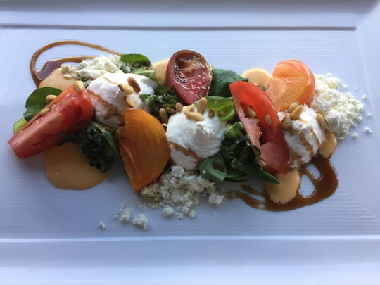 """Sauce vierge, a tomato-basil preparation that means """"virgin sauce"""" in French, adds interest to an heirloom and burrata salad at the Shore Room restaurant in the Renaissance Reno hotel."""