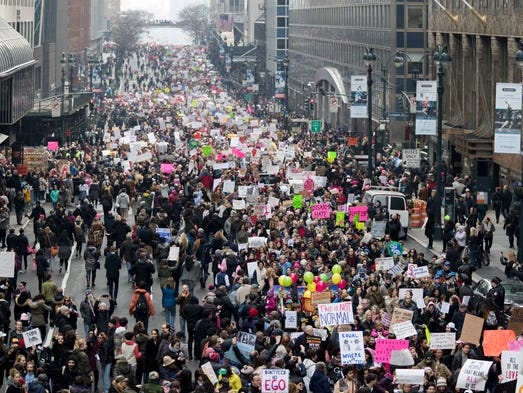Demonstrators march across 42nd Street during a women's