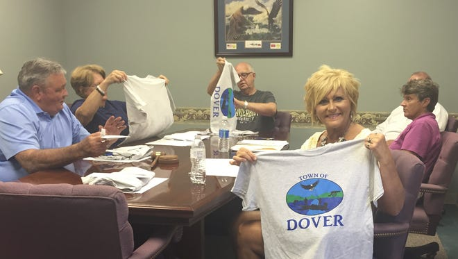 Dover Mayor Lesa Fitzhugh displays a T-shirt with the Town of Dover's new logo.