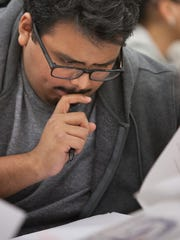 Jonathan Cruz reads over an investigation bulletin during the advanced crime scene class at Florida SouthWestern State College in Fort Myers on Jan. 11.