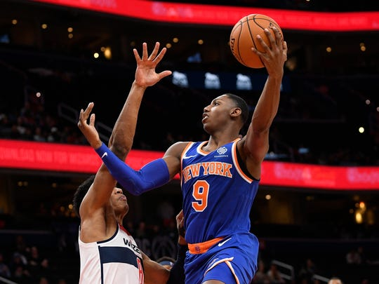 New York Knicks forward RJ Barrett (9) shoots against Washington Wizards forward Rui Hachimura, left, during the first half of an NBA preseason basketball game, Monday, Oct. 7, 2019, in Washington. (AP Photo/Nick Wass)