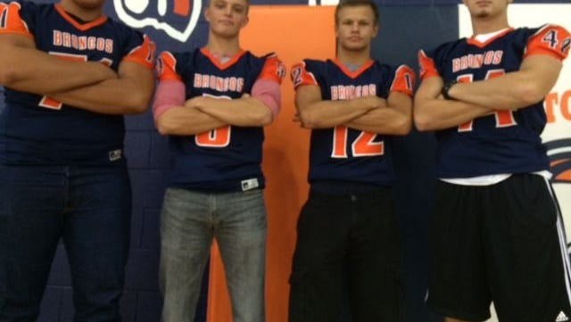 Poston Butte football players Emilio Garcia, Russ Corriveau, Hayden Brimhall and Chris Musselman are ready to lead Paul Moro's  first team in Division II.