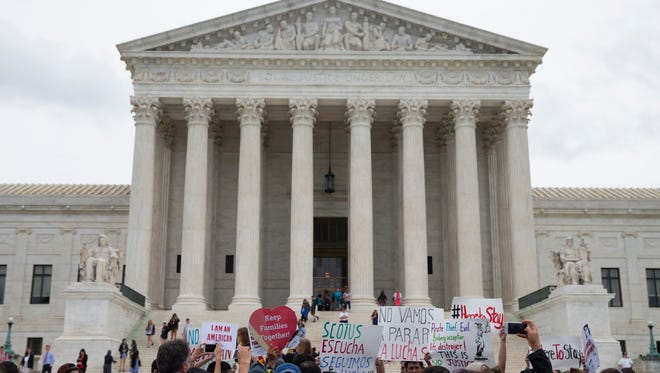 Demonstrators gather outside the Supreme Court in Washington, Thursday, June 23, 2016.  In a major victory for affirmative action, a divided Supreme Court upheld the University of Texas admissions program that takes account of race. The justices voted in favor of the Texas program by a 4-3 vote, an outcome that was dramatically altered by the death of Justice Antonin Scalia, who opposed affirmative action. (AP Photo/Evan Vucci)