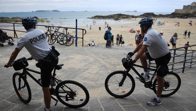Policemen patrol on bike close to the beach of Saint-Malo, western France on July 21, 2016.