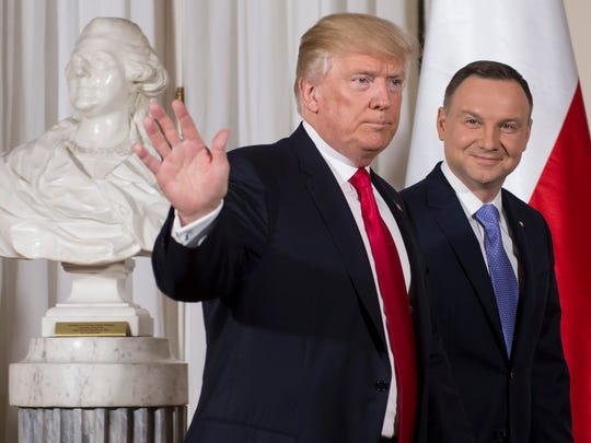 Polish President Andrzej Duda greets President Trump during Trump's first visit to the country in 2017. Trump canceled a two-day trip to Poland this weekend and is sending Vice President Mike Pence in his place.