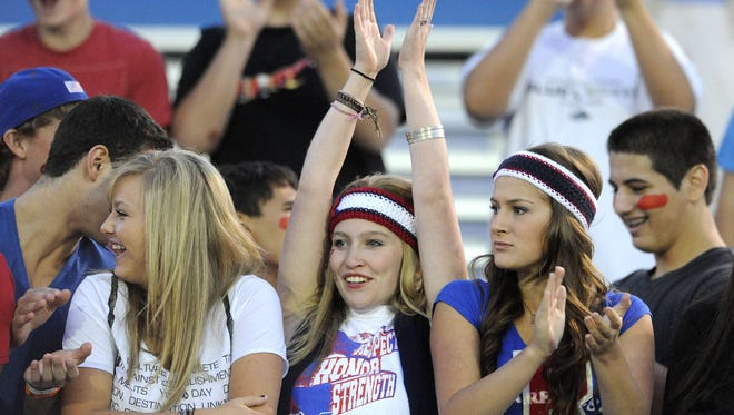 Reno fans cheer on their team during the game between Reno and Damonte Ranch on Thursday, Sept. 1, 2011.