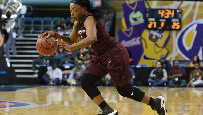 Eastern Shore's Dayona Godwin drives to the basket against Coppin State at the MEAC Basketball Championships in Norfolk, Va., on Monday, March 6, 2017.