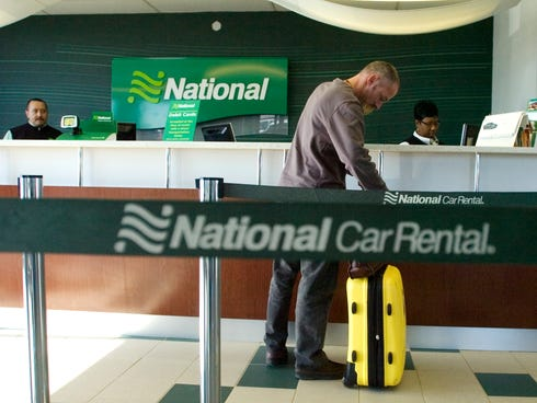 Andy Bucher, of Miami, picks up a car from National Car Rental at O'Hare International Airport in Chicago on Nov. 2, 2009.