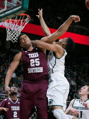 Texas Southern's Joshua Friar swats the shot of MSU's Alvin Ellis during the second half Saturday in East Lansing. Texas Southern won, 71-64.