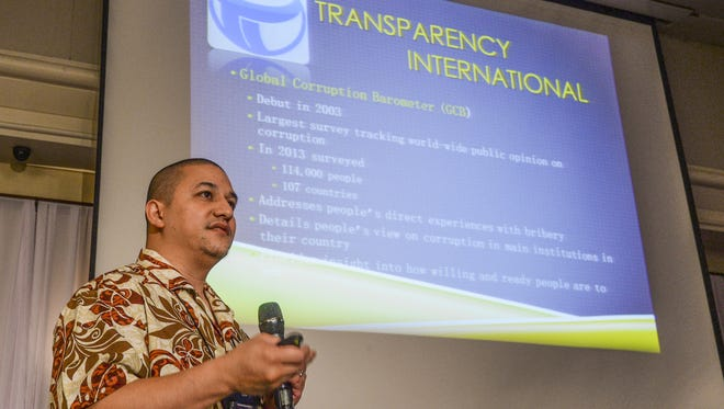 John Rivera, University of Guam Master of Public Administration program chairman, explains the results of a corruption survey, conducted on Guam and the Federated States of Micronesia, during the Western Pacific Conference on Public Administration and Policy Solution at the Hyatt Regency Guam in Tumon on Nov. 24.
