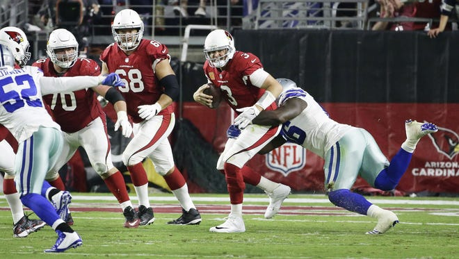 Arizona Cardinals Carson Palmer is sacked by Dallas Cowboys Maliek Collins in the first half during Monday Night Football on Sep. 25, 2017 in Glendale, Ariz.