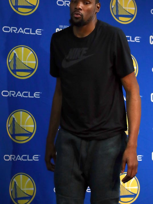 Golden State Warriors' Kevin Durant leaves a media conference on Friday, March 16, 2018, in Oakland, Calif. Durant announced he will miss 1-2 weeks to allow a rib injury to heal. (AP Photo/Ben Margot)
