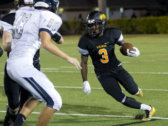 Bishop Verot's William Scott runs the ball against Out-of-Door Academy on Friday, October 3, 2014, at Bishop Verot High School.
