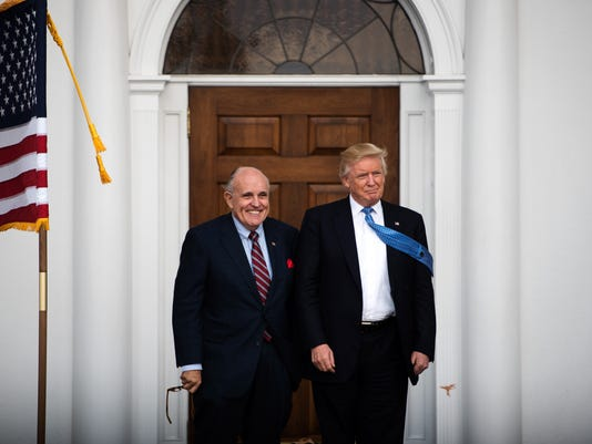 President-elect Donald Trump and Rudy Giuliani, former mayor of New York, outside the clubhouse at Trump National Golf Club in Bedminster.