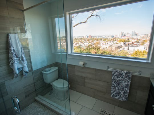 A clear view of downtown Cincinnati can be seen from the wide window of the master bathroom of David Burns' Newport home.